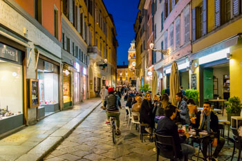Bars on the Farini street in the evening, Parma, Italy