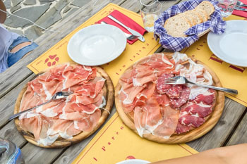Cold Cuts: Parma ham and salami in a refuge Lagdei in the 100 lakes park, Italy