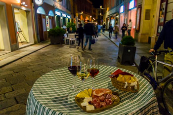 Local Italian aperitif: wine, cheese and meat cut, Parma, Italy