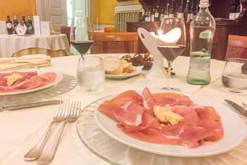 Parma ham and Parmigiano Reggiano cheese at La Filoma restaurant, Italy