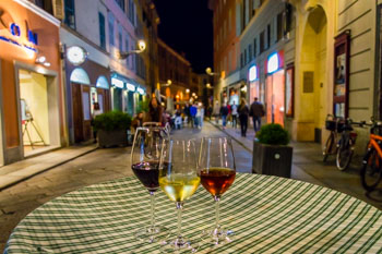 Wine in the enoteca on Farini Street, Parma, Italy